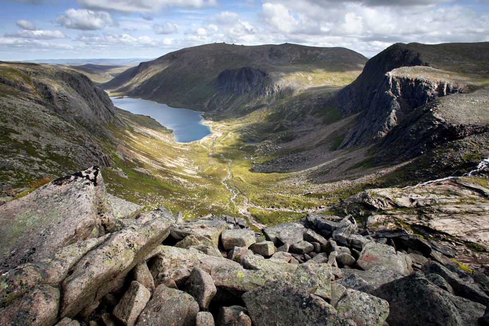 The awesome Shelter Stone Crag (right) stands over Loch Avon deep in the Cairngorms. Photo: Alamy