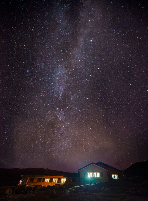 The Milky Way streaks the crystal-clear night sky above the refuge.