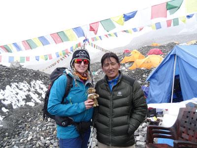 Vanessa passes the marmot shaped baton over to Pemchhiri Sherpa.