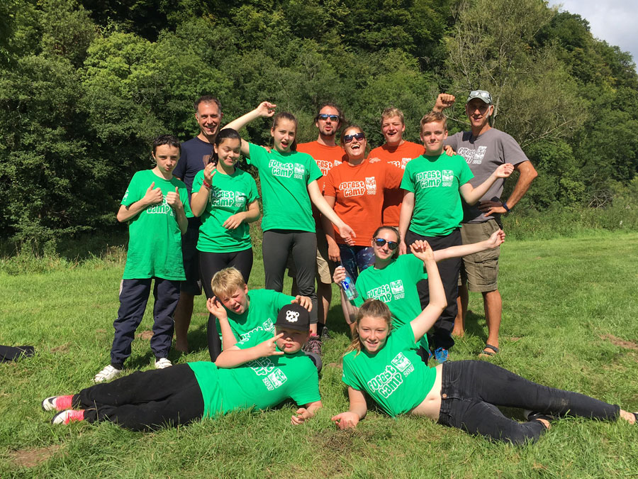 Mark Brigham (top left) of Ellis Brigham with a group of young people enjoying the Youth Adventure Trust's six day Forest Camp.