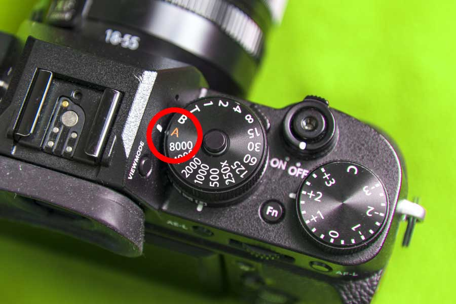 Aperture priority: Use the aperture priority mode on your camera, denoted by an A, or Av.