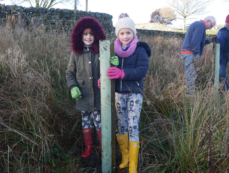Iris and Nancy help out with community tree planting at Hebden