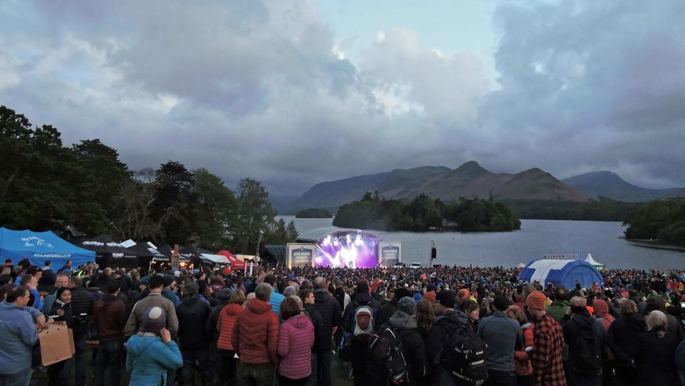 The Keswick Mountain Festival Live Music Stage with the dramatic backdrop of Derwentwater and Catbells