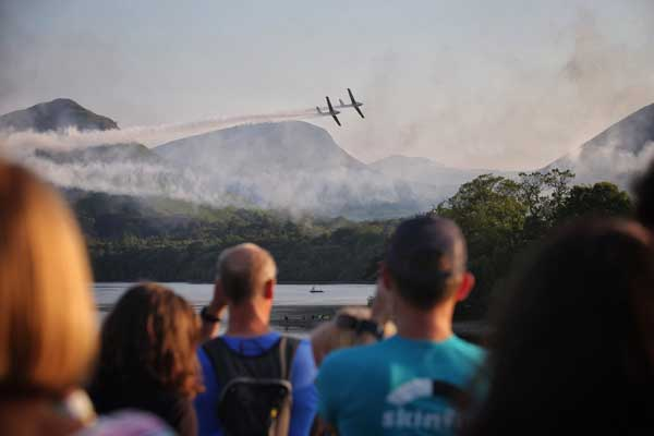 Visitors at Keswick Mountain Festival watch aerobatics over Derwentwater - photo by Dougie Cunningham