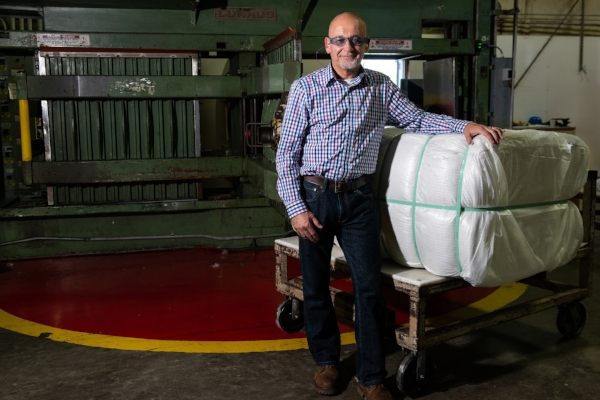 PrimaLoft Product Engineer Robert Dempsey with the first bale of fine denier high performance PrimaLoft biodegradable fibre.