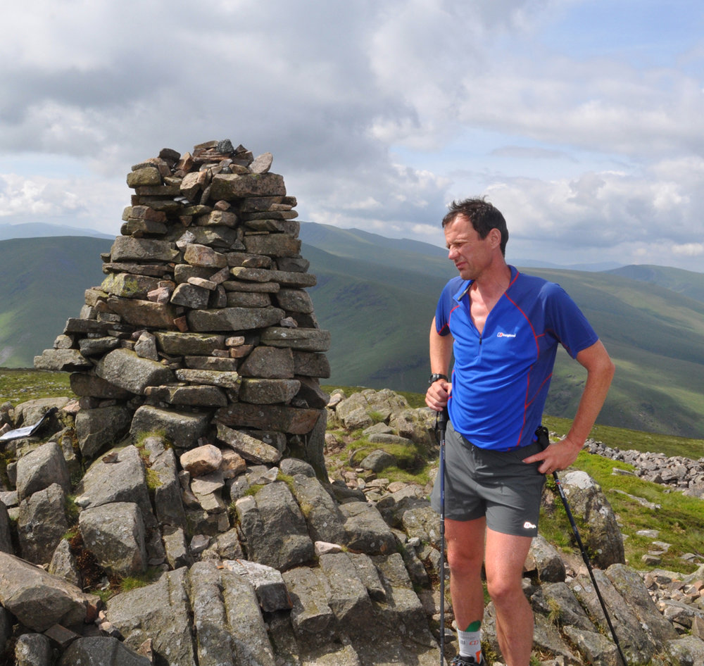 Steve Birkinshaw on the summit of Carrock Fell during his record breaking Wainwrights run