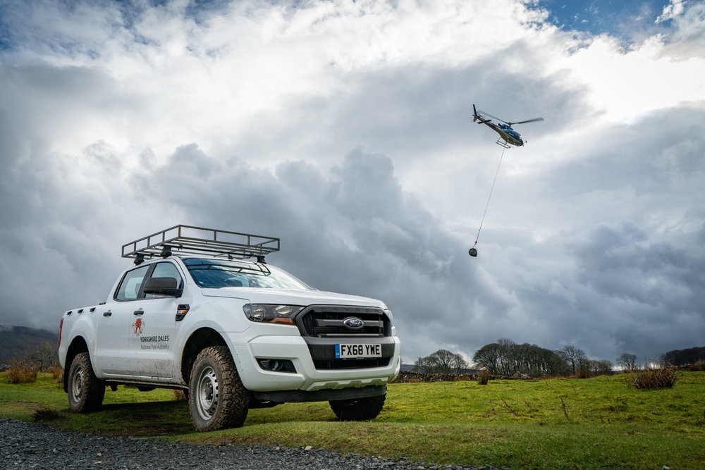 Stone being airlifted near Whernside. Photo: Andy Kay / YDNPA