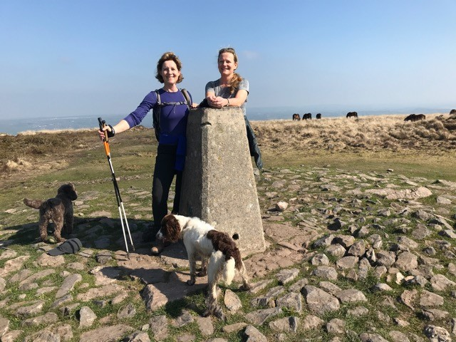 Vicky with Cappuccino and our dogs Alfie and Otis at the trig point on Beacon Batch, Mendips