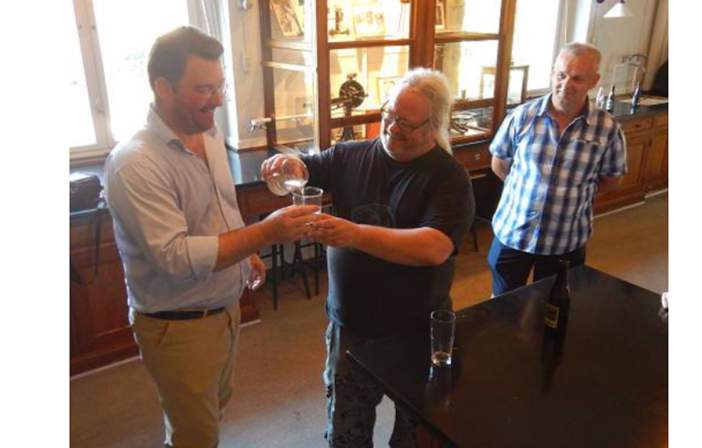 Ronan Boutot and Fred Poeser together introduce the two guppies to each other in the Carlsberg Laboratory, with Eamon Broderick looking on.