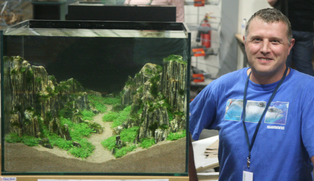 Stephen Rhodes with his winning aquascape, called 'Snake Pass'.