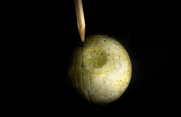 The Death Star model has just a few corals growing on it, indicated by the pencil.