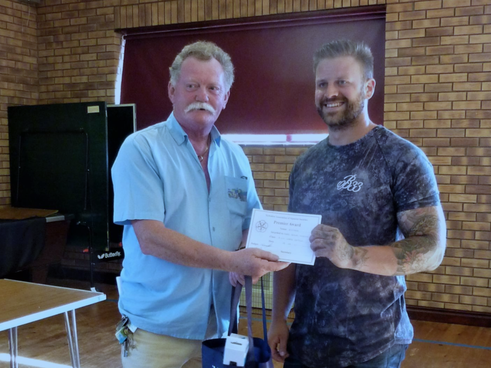 Marc receives his award from Steve Jones of the Yorkshire Association of Aquarist Societies.