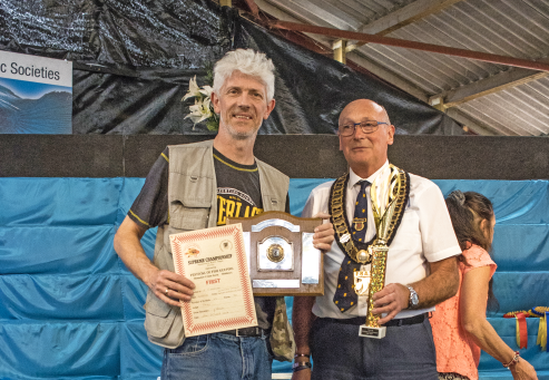 Allan Finnegan (left) collects one of his many awards at this year's Festival.