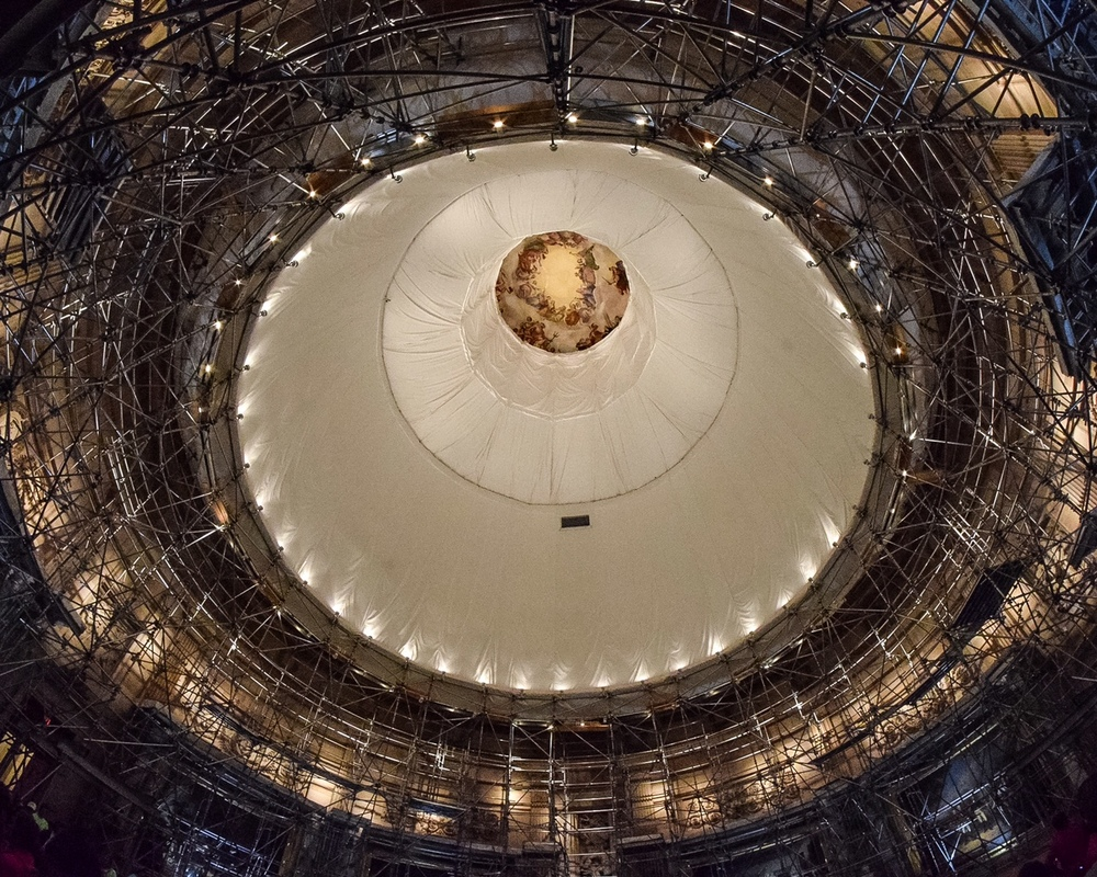 "In September 2016, the $60 million Capitol Dome restoration will wrap up and scaffolding will be removed, once again offering visitors full views of the stunning rotunda topped by ""The Apotheosis of Washington,"" a fresco by Italian-born artist Constantino Brumidi.  To give an idea of the height of the rotunda, the fresco (still visible through the protective sheeting) actually encompasses more than 4,600 square feet."