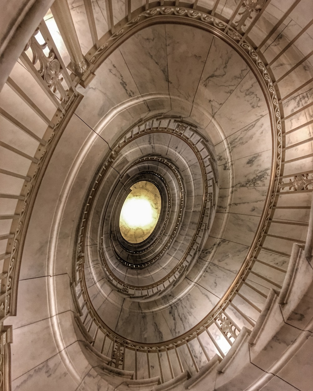 The US Supreme Court building features two self-supporting marble spiral staircases. Touring the building is free, as is attending oral arguments in the courtroom (seating is extremely limited and done on a first-come, first-served basis).