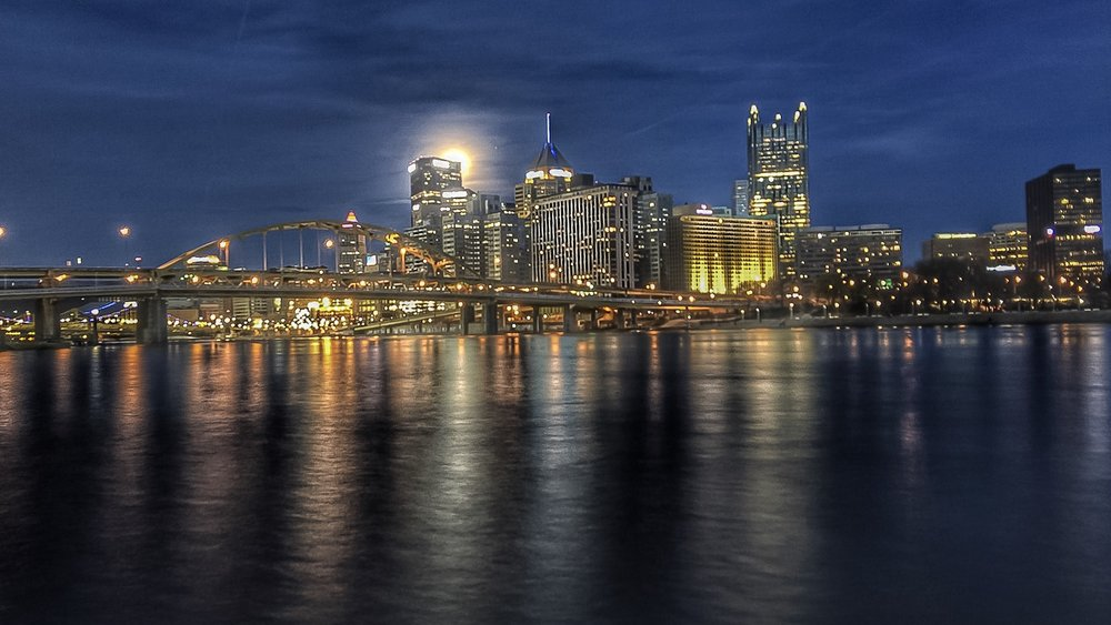 Moon rising over downtown