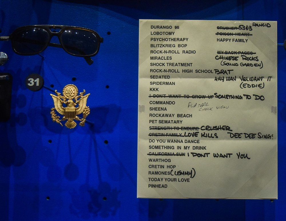 Sunglasses, pin, and setlist from final Ramones concert.