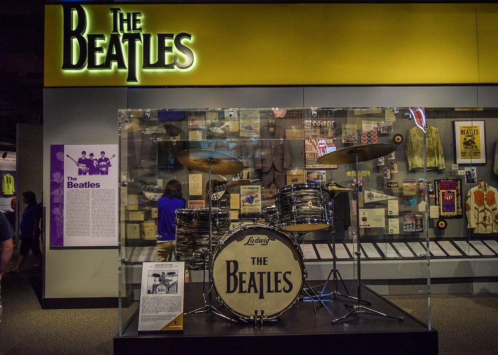 Yeah yeah yeah. Among the costumes, dolls, lyrics, and more sits Ringo Starr's drum kit.