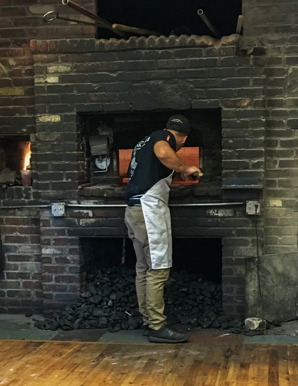 Working the oven at Frank Pepe's. This New Haven, CT landmark has been producing out-of-this-world pizza in the same spot since 1928.  If you ever have the chance to go, GO! The shrimp and fresh garlic white pizza I had was, without question, the best pizza I've ever had.