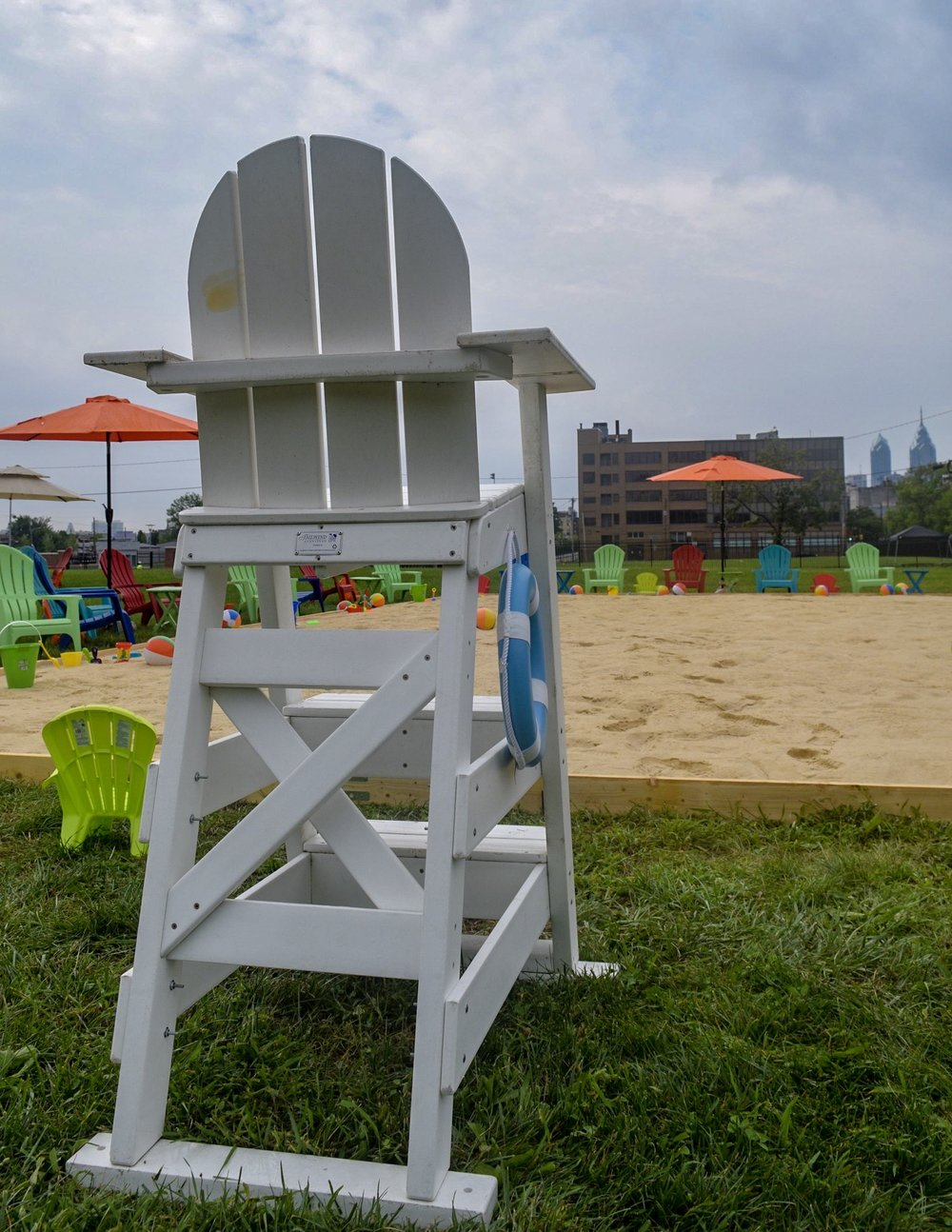 the Beach On North Broad, featuring beach chairs, beach balls, hammocks, and 50 tons of sand