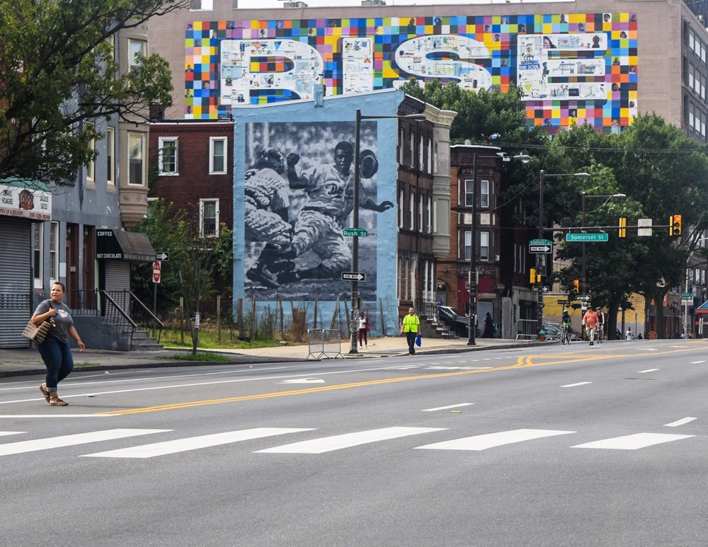 Two of the more than 4,000 murals in the city of Philadelphia.