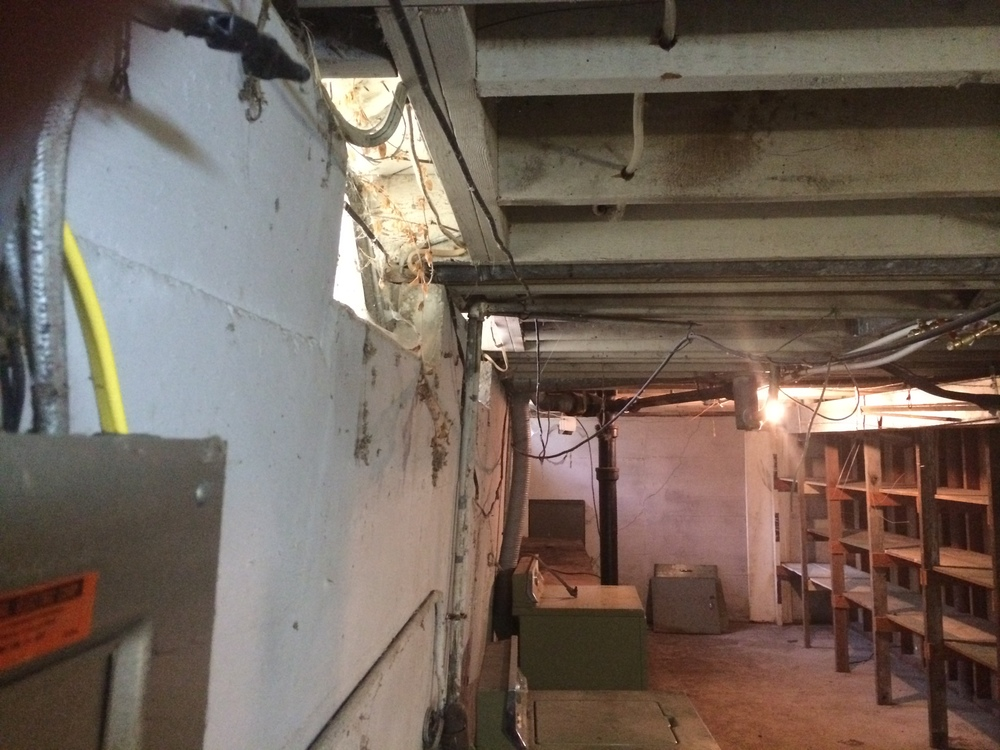 Bowed basement wall that needs repair.