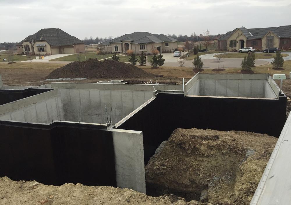 Basement waterproofing applied on walls.
