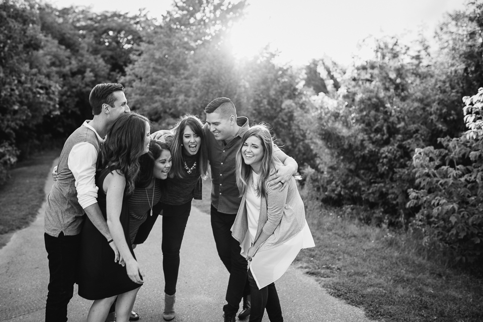 6 adult siblings laughing together in park - Stouffville lifestyle photography
