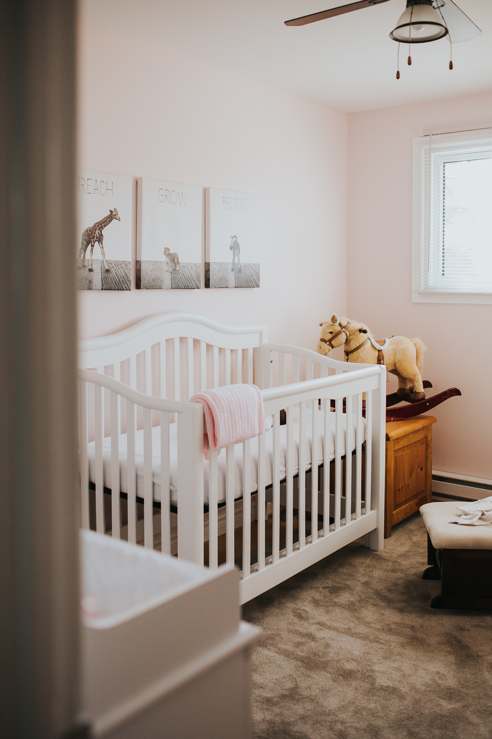 pink baby girl nursery with rocking horse - Markham newborn photography