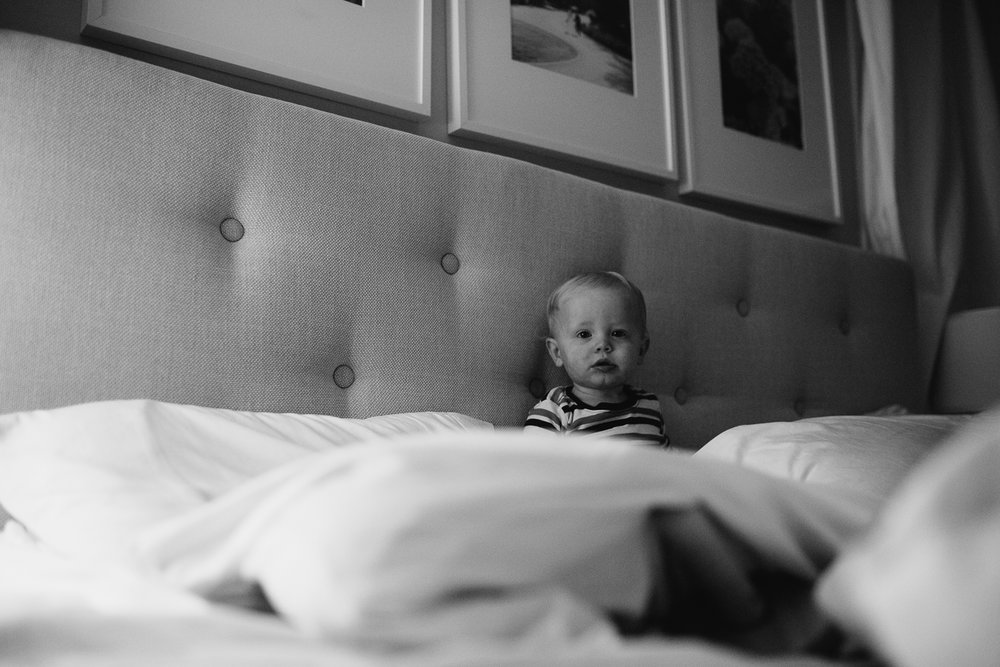 1 year old baby boy sitting on bed - stouffville child photos