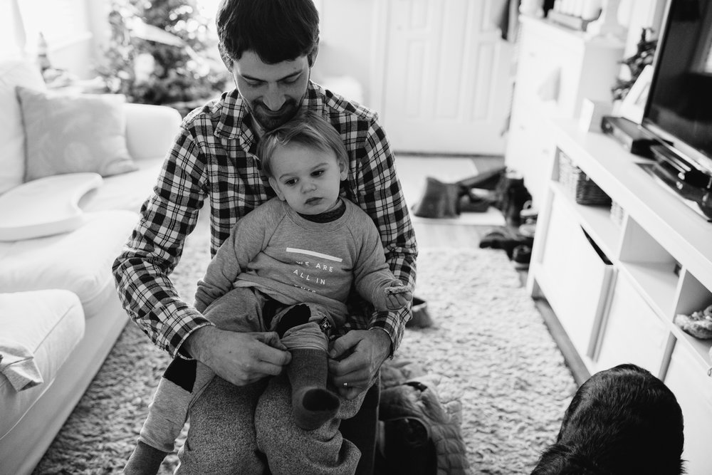 2 year old toddler boy getting dressed with dad {Toronto Family Photographer}