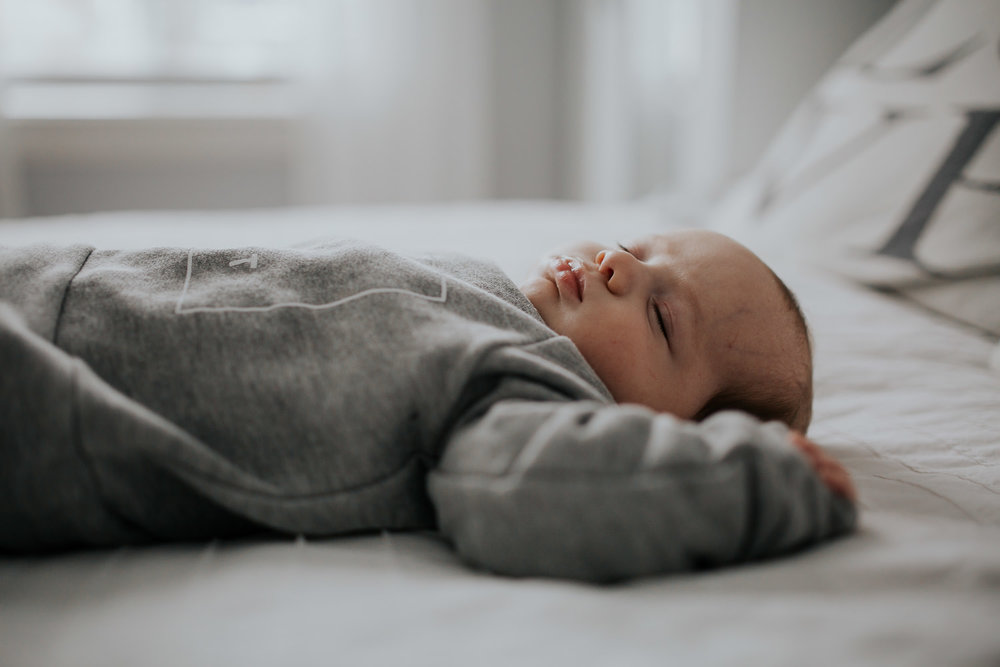 2 month old baby boy asleep on bed - Stouffville baby photos