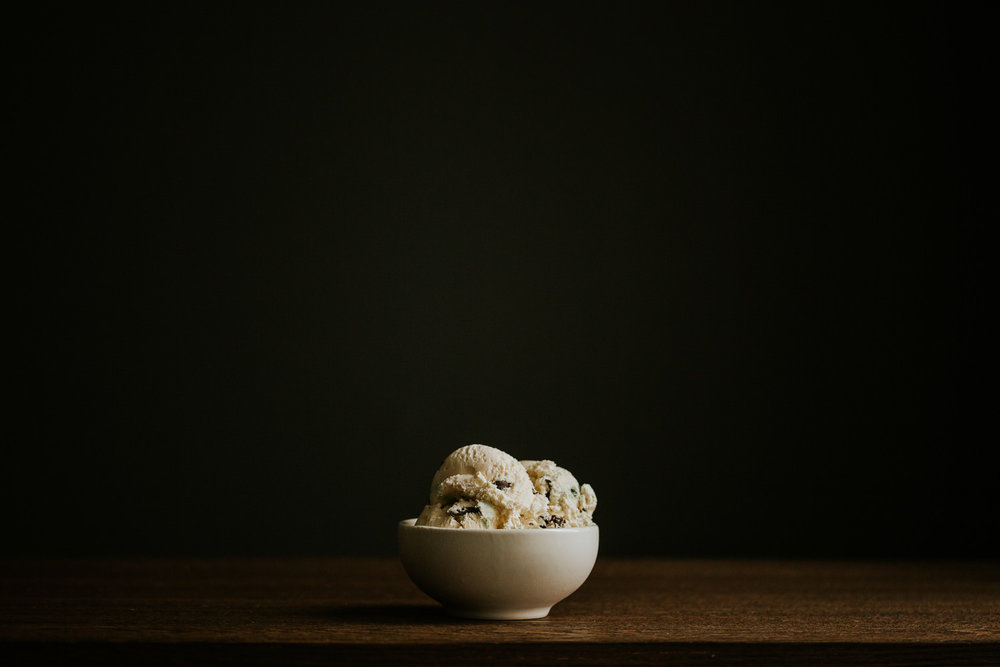 candy cane ice cream in white bowl on wood table - Toronto food photography