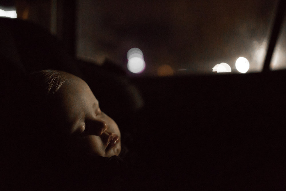 1 year old baby boy asleep in car seat at night - Stouffville Child photos
