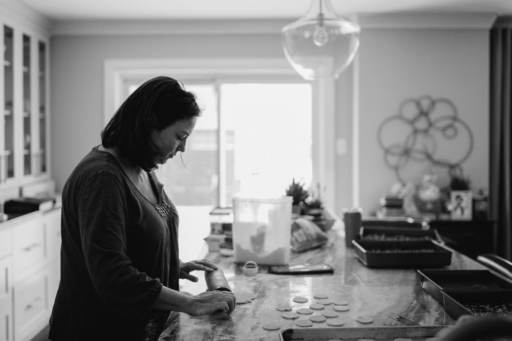 woman baking christmas cookies in large kitchen - uxbridge in-home photography