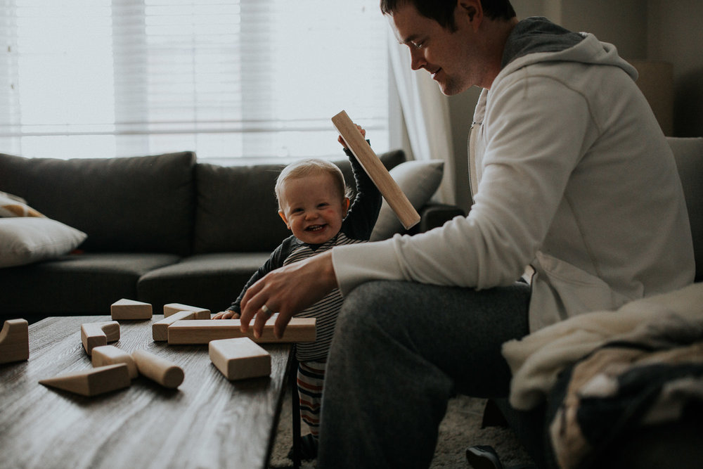 1 year old toddler boy and dad playing with wooden blocks - markham in-home photos