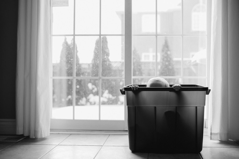 1 year old toddler boy hiding in plastic bin - stouffville child photography