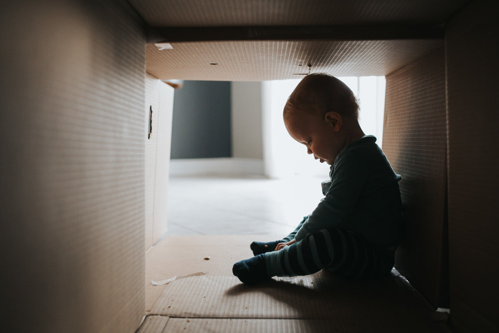 1 year old toddler boy sitting in cardboard box fort - markham child photos