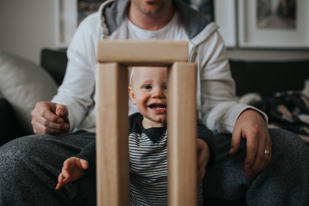 1 year old baby boy playing with wood blocks with father - Newmarket lifestyle photography