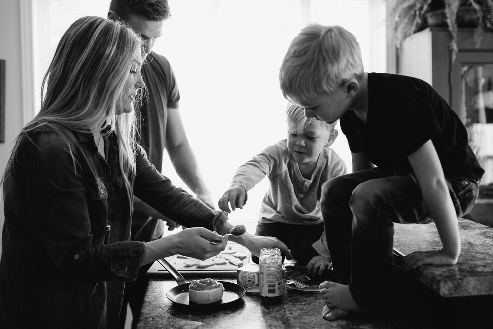 family of four with 2 young blonde boys preparing meal in kitchen - Stouffville lifestyle photography