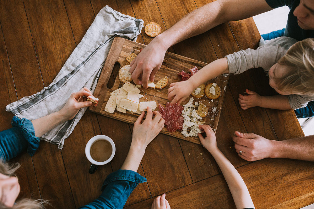 family of four sharing cheese board - uxbridge lifestyle photos