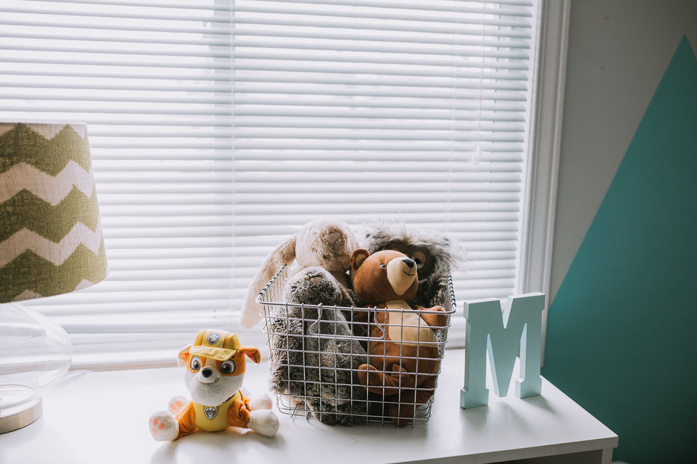 basket of stuffed animals in basket on bedroom dresser - newmarket lifestyle photos