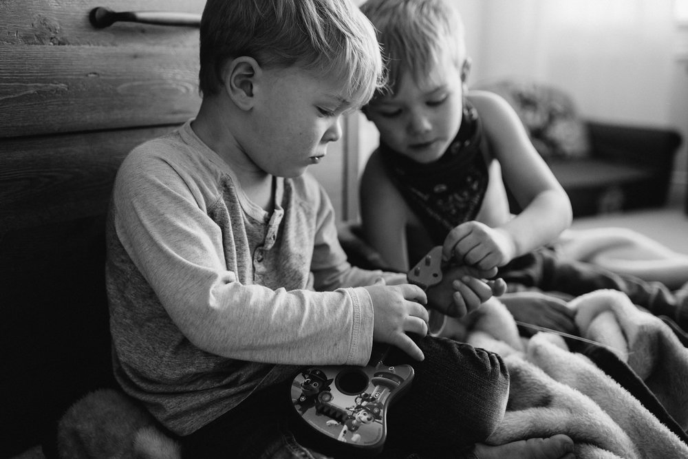 young blonde brothers playing with toy guitar - Stouffville child photography
