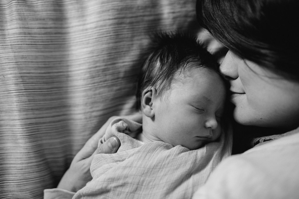 new mom snuggled face to face with 2 week old baby daughter - Barrie lifestyle photography session