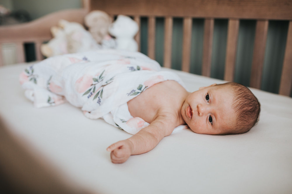 6 week old baby girl lying swaddled in crib - Markham in-home photography