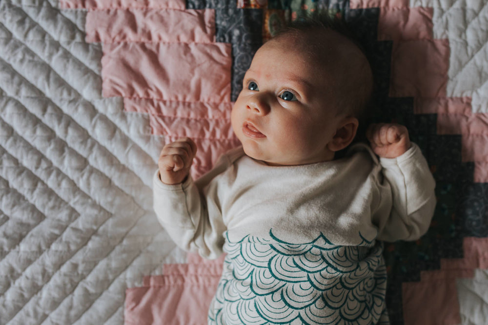 5 week old awake baby girl lying on handmade quilt - Newmarket lifestyle photos