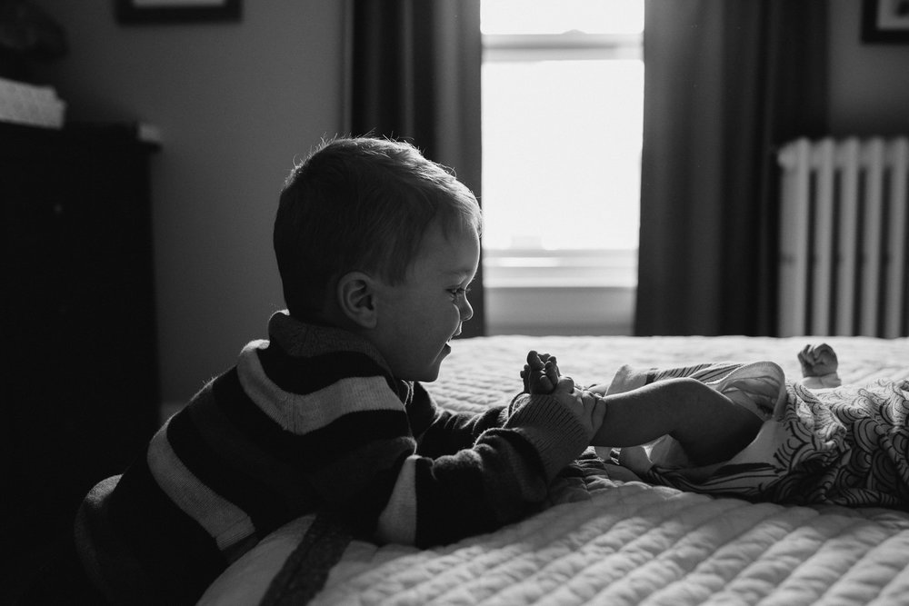 3 year old big brother playing with baby sister's feet - Barrie lifestyle photos