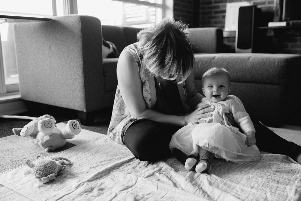 mom sitting on floor with smiling 5 month old baby girl - Markham lifestyle photography