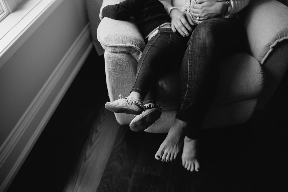 2 year old toddler girl and mother's feet, sitting in glider - Barrie in-home photography