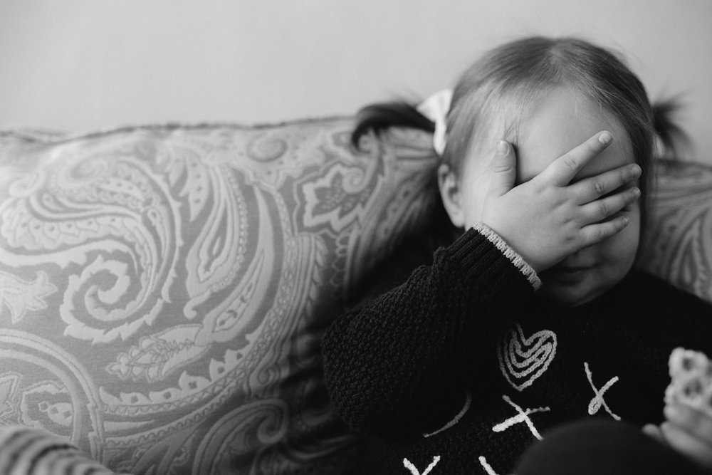2 year old toddler girl covering face with hand - Newmarket lifestyle photography